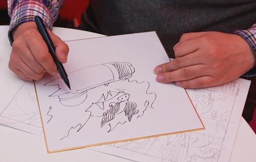 Satoshi Yamamoto en train de dessiner